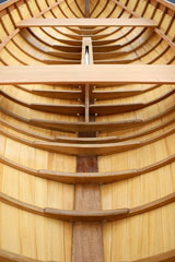 constructing a wooden boat, using a traditional boatbuilding process