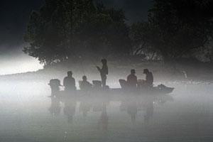 fishermen in a motorboat on an Arkansas lake