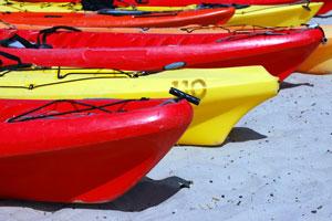 ocean kayaks on a Monterey, California beach