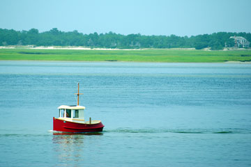 little red boat in Cape Cod Bay