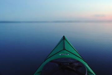 kayak on Devils Lake, North Dakota at sunset