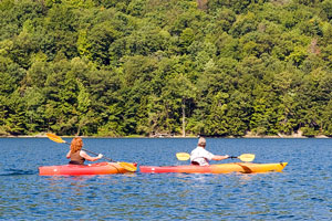two kayakers kayaking on Canadice Lake in upstate New York