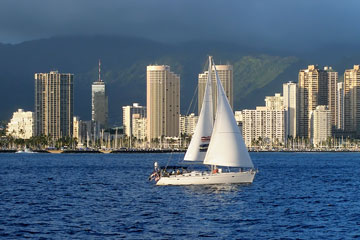 sailboat with Honolulu skyline in the background