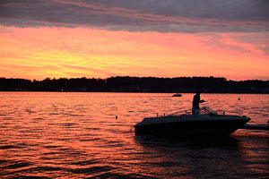 fishing from a boat at sunset, on an Indiana Lake