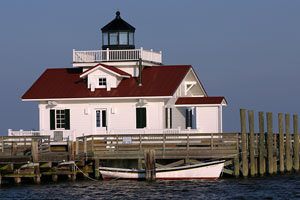 Manteo lighthouse and dory in Albemarle Sound