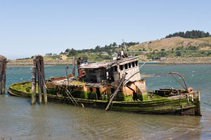 old, decrepit boat in the Rogue River