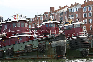 three tugboats at a Portsmouth, New Hampshire dock