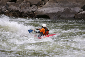 kayaker navigating rapids on a West Virginia river