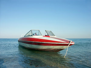 red and white motorboat